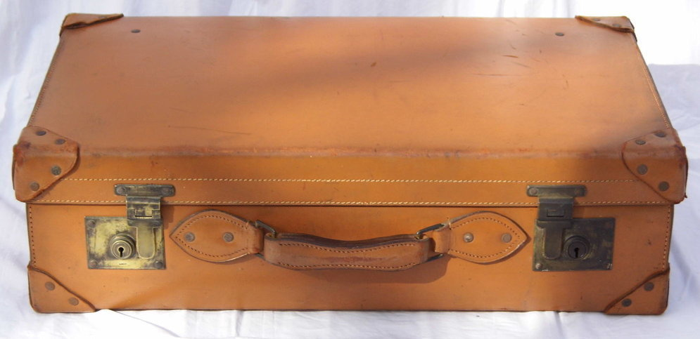 1940s light brown thick leather suitcase with solid brass locks